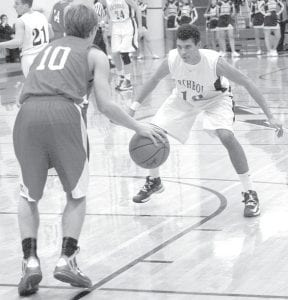 Archbold's Taylor Price guards a Patrick Henry player as the Patriot brings the ball up the court, Friday, Jan. 18.– photo by Scott Schultz