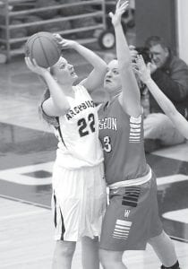 Wauseon's Annette Stidham couldn't stop Hannah Hesterman (22) from scoring. The AHS sophomore scored 17 points in the 62-48 victory.– photo by Mary Huber