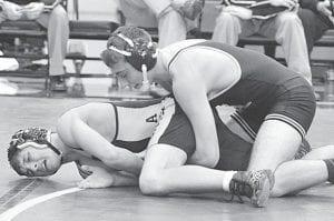 Garrett Grime won an 11-3 major decision over N. Chase Carpenter.– photo by Mario Gomez