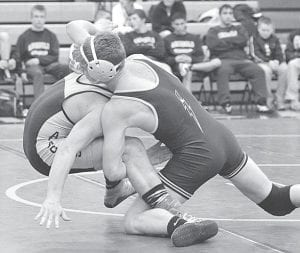 Logan Day pinned Fairview's Kolbe Roose at 1:35 to win at 145 pounds.– photo by Mario Gomez