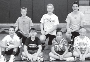 The Archbold Knights of Columbus free-throw shooting contest was Saturday, Jan. 19. Winners advancing to the district and their age groups are, front row from left: Travis Ziegler, 12; Nathan Rettig, 11; Naomi Rodriguez, 10; Andee Grime, 12. Back row: Bryce Williams, 13; Peyton Dickman, 13; Alex Short, 14. Absent: Brandon Taylor, 10; Alexa Wilson, 11.–courtesy photo