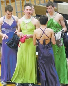 Several junior and senior players on the AHS boys basketball team put on prom dresses for the