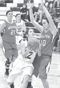 Hilltop's Jackie Smith (10) tries to stop Pettisville's Mikala Avina (12) from getting a clear shot in the Blackbirds' BBC contest with the Cadets, Thursday, Feb. 7. Avina scored four points in the contest and eight against Patrick Henry, Tuesday, Feb. 5. –photo by Mario Gomez