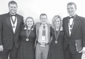 Four Archbold High School students sang with the All-State Choir during a performance at the Ohio Music Educators Association convention in Columbus the weekend of Feb. 9-10. Out of as many as 800 students from across Ohio who audition for the choir, only 161 are selected. Only six other Ohio schools sent four or more students. With Kent Vandock, AHS director of choral music activities (center) are the four students, from left: Adam Steider, Julianne Sparks, Gabrielle Deskins, and Caleb Wyse.– courtesy photo