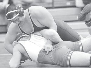 Travis Jaramillo (195 lbs.) tries to turn Delta's Mark Francis onto his back in the Division III sectional tournament, Friday and Saturday, Feb. 15-16. Jaramillo won his second straight sectional title.– photo by Mario Gomez