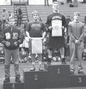 Logan Day took first place in the 138-pound weight class at the Division III sectional tournament at AHS. From left: Christian Valentine, Delta, fourth; Zach Niner, Liberty Center, second; Day; Sammy Santa-Rita, Edgerton, third.–photo by Mario Gomez