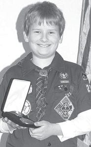 Levi Baus, 10, a member of Archbold Cub Scout Pack 263, with the medallion representing the Scouts' Super Nova award. Less than 1% of scouts in the U.S. have earned Super Nova.– photo by David Pugh