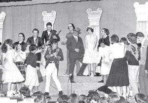 """David McDonel takes the cast of """"Bye Bye Birdie"""" through a scene in 1977. Tom Ehrman directed the 20-piece orchestra that accompanied the musical. A total of 190 high school students were in the production. The 2013 AHS production of """"Bye Bye Birdie"""" will be presented April 12-14.–photo from the archives of the Archbold Buckeye"""
