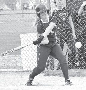 Paige Peterson hits a sacrifice fly to right field, Tuesday, April 23, in a suspended game with Stryker.– photo by Mario Gomez