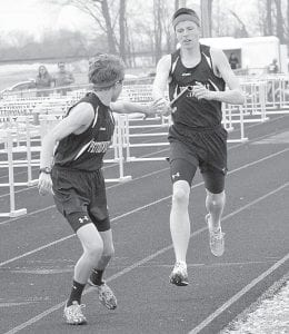 Pettisville's Kyle Lantz takes the handoff from Tim Iott in a Pettisville track meet, Tuesday, April 9. The 4x800 team with the duo and Jeremy Mann and Dominic Frey won the event at the Diller Invitational, Saturday, April 27.– photo by Mario Gomez