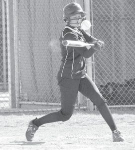 Pettisville senior Mackenzie Riegsecker makes contact with the ball. She hit singles against Tinora and Fayette last week.– photo by Mario Gomez
