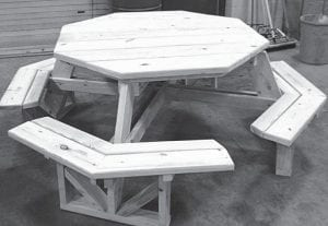 Using money generated by the Outdoor Power Equipment Clinic, members of the Archbold FFA built an octagonal picnic table, above, and a King Arthur glider that were donated to the ABC 4 Maddy auction.– courtesy photo