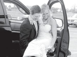 """Students found unique ways to arrive for the AHS prom, Saturday, May 4. Top: Zach Short, a senior, gives Natalie Rupp a lift from a large pickup truck as they prepare to enter the prom. Rupp is an AHS sophomore. Left: Tyler Bryan, a senior, rides in on a stick-unicorn, """"Princess Cinnamon.""""–photos by David Pugh _________________________"""