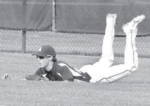 Jase Grosjean makes a diving catch for an out in Archbold's NWOAL matchup with Wauseon, Thursday, May 2.– photo by Mario Gomez