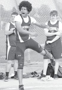 AHS sophomore Isaac Burkholder placed first in the shot put and discus in Archbold's meet with Montpelier, Tuesday, April 30.– photo by Mario Gomez