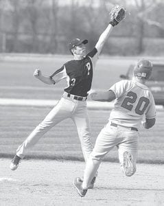 A Hilltop runner steals second as Pettisville's Cam Norris can't tag the Cadet in time. The Birds won a 10-0 five-inning shutout, Thursday, May 2.– photo by Mary Huber