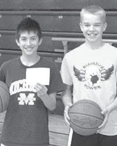 Noah Rocha, left, and Landon Roth won the junior high hoop shoot at Pettisville.– courtesy photo