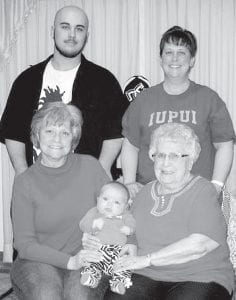 Five generations of the Nafziger family recently gathered for a family photo. Alexus Lynn Flores, born Jan. 13, is held by greatgrandmother Kathleen Nafziger Short, left, Pettisville, and greatgreat grandmother, Lodema Nafziger, Pettisville. Standing are Alexus' father, Christian Flores, Marion, Ind., and grandmother, Kimberly Short Flores, Marion, Ind.– courtesy photo