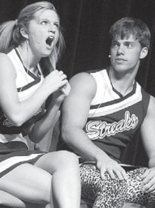 Gabrielle Deskins and Tyson Lersch perform a skit about cheerleaders during the Archbold High School talent show, Friday, May 17.– photo by David Pugh