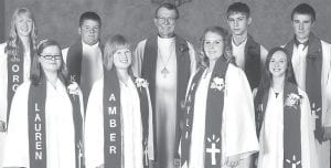 St. John Lutheran Church, rural Stryker, held confirmation, Sunday, May 5. Confirmands are, front row, from left: Lauren Lands, Amber Wendt, Kayla Beaverson, Madison VanScoder. Back row: Morgan Miller; Kyle Kinsey; Dale Kern, pastor; Blake Harwell, Levi Carmody.– courtesy photo