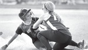 Cassidy Wyse is safe at third base in the fourth inning of Archbold's sectional final with Tinora. The Streaks advanced to the district semfinal with a 7-0 victory.– photo by Mary Huber