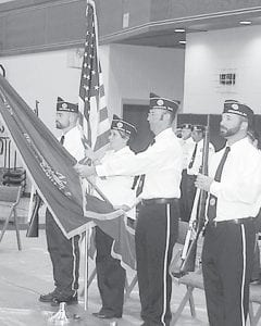 Top: Members of the Archbold American Legion Post 311 color guard, during the Memorial Day ceremony at Pettisville, Monday, May 27. From left: Randy Grime, Amy Hammersmith, Abe Dominique, and Dan Grime. Bottom: members of the Ridgeville Corners Legion Post 454 fire three volleys. From left: Ted Ripke, Bob Norden, and Elmer Maassel.– photos by David Pugh and Mary Huber