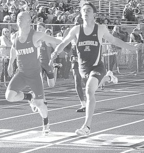 Eastwood's Isaiah Conkle edges out Levi Wyse by 18 onehundredths (.18) of a second to win the 100-meter dash at the Div. II district track meet. Wyse was the district champion in the 200 and 400.– photo by Kim Parsley