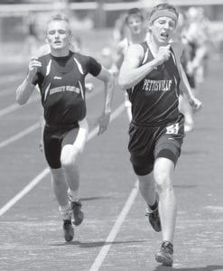 Pettisville's Jeremy Mann, right, edges out Liberty Center's Henry Elling to win the 800-meter district championship at the Div. III district track meet, Saturday, May 25. Mann won in 2:01.63; Elling finishing in 2:02.69.– photo by Mary Huber