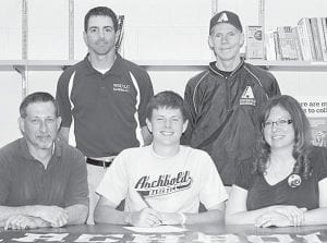 Zach Short, an Archbold High School senior, signs a letter of intent to play baseball at the Wright State University Lake Campus, Celina. Seated with Short are his parents, Lonnie and Tina. Standing are Rob Howell, WSULC coach, and Dick Selgo, AHS head coach.– photo by Mary Huber