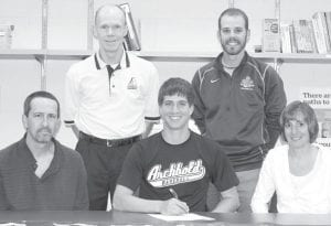 Michael Walker, an Archbold High School senior, signs a letter of intent to play baseball at Goshen (Ind.) College. Seated with Walker are his parents, Greg and Kim. Standing are Dick Selgo, AHS head coach, and Alex Childers, GC head coach.– photo by Mary Huber