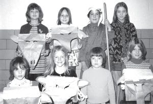 """Old Photo Corner: Archbold fourth graders perform """"The Wolf In Sheep's Clothing"""" in 1974. Front row, from left: Tammy Wilson, Barbara Barnhart, Patrick Kelly, Laura Nafziger. Back row: Norma Wyse, Lynette Beck, Chris Liechty, Amy Croyle.– photo from Archbold Buckeye archives"""