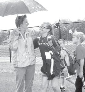 Dorothy Lambert, left, Archbold Elementary School principal, says goodbye to Megan Waidelich on May 28, the last day of school for the 2012-13 school year. It's a special goodbye for Waidelich, as she starts fifth grade at Archbold Middle School in the fall.– photo by David Pugh