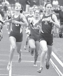 Jensyn Garrow, right, crosses the finish line just ahead of Gilmour Academy's Alexis Anton, left, to finish third in the Division III 4x400-meter girls relay at the state track and field meet, Saturday, June 8, in Columbus. Other members of the relay team are Meridith Short, Kassidy Garrow, and Tressa Parsley.– photo by Mike Nafziger