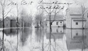 A rare 1908 photograph reveals the heavy flooding on West Street, south of the railroad in Archbold. The postcard photograph was written by Jacob Funkhouser to his brother, Bert, on March 29, 1908, when he said it rained for a week earlier in the month. Notice the man in a row boat and a man on the front porch.– Antique photograph from the collection of Deb Lecklider, Bert's granddaughter
