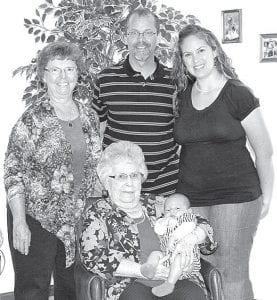Lodema Nafziger, Pettisville, holds great-great-grandson Colton Daniel Slye, born April 2, 2013. Standing, from left: Dianne (Nafziger) Yoder, Colton's great-grandmother, Pettisville; Douglas L. Yoder, Colton's grandfather, Pettisville; and Stephanie (Yoder) Slye, Colton's mother, Springfield.– courtesy photo