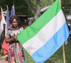 Mabinty Sesay holds the national flag of Sierra Leone before becoming a US citizen. She now lives in Huron.