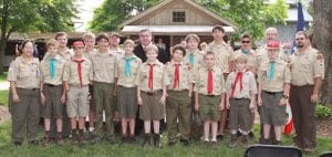 Archbold Boy Scout Troop 63 stand with the Honorable James R. Knepp, II. The Boy Scout troop led the Pledge of Allegiance for the new US citizens.