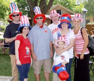 Mireille Rebeiz (second from left) celebrates becoming a new US citizen with her family at Sauder Village. From left: husband Stacey Suver; Rebeiz; Stacey's brother, Ryan Case, Columbus; Stacey's parents, Bill and Pam Suver, Columbus; Ryan's son, Ethan, 5; and Ryan's wife, Stephanie.-photos by Mary Huber