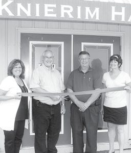 The ribbon was cut Monday, July 8, for the opening of The Marketplace at Knierim Hall, offering gifts, collectibles, specialty foods and art from local artisans and vendors. From left: Janet and Kevin Knierim, owners; Dennis Howell, Archbold village administrator; and Julie Brink, director of the Archbold Area Chamber of Commerce.– photo by David Pugh