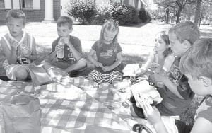 """Youngsters enjoyed a picnic on the lawn of the Archbold Community Library, Monday, July 15. It was part of the summer reading program; the theme of the event was """"Picnic With The Ants."""" Enjoying themselves are, from left: Joey Ripke, 7, Zach Nafziger, 8, Paisley Suon, 5, Ella Throne, 7, Finn Suon (Paisley's brother) 6, and Elias Riegsecker, 6. All are from Archbold except the Suons, who are from Wauseon.– photo by David Pugh"""