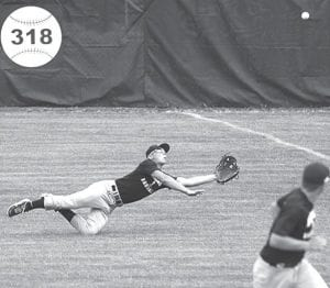 Right fielder Mitchell Hogrefe makes a diving catch for the third out in the first inning of Archbold's game with Coldwater, Saturday, July 20.– photos by Mary Huber