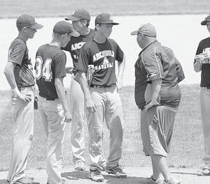 Conference on the pitcher's mound with Derric Martinez, head coach.