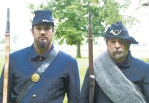 Wade Knipp, and father Steve, in their civil war uniforms. They are Civil War reenactors who participate in restaging battles of the war. The Knipps have a link to the war– Steve's great-great grandfather was a soldier at the Battle of Gettysburg.– courtesy photo