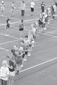 Members of the Archbold High School Marching Band were working on one of their formations, which required them to form a straight line, during the first day of band camp, Monday, Aug. 5. Beth Voll, band director, said this was very good for the first day.– photo by David Pugh