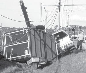 A utility pole was snapped in two as a result of a single-vehicle accident, Sunday evening, Aug. 4. Archbold Rescue was called to the crash scene at 7:32 pm, after the pickup truck pulling a cargo trailer went off the north side of East Lutz Road and struck the pole. Michael Hetz, Bryan, driver of the vehicle, was taken to the Fulton County Health Center by Archbold Rescue. He was treated and released. Archbold police are still investigating.– photo by David Pugh