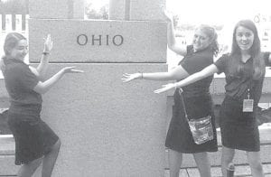 Hannah Meller, Mikayla Crouch, and Erin Betz, from left, visit the World War II monument in Washington, D.C. The tour of the monuments is a way to connect to many times and activities throughout history.– courtesy photo