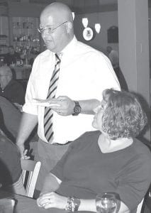 The Archbold Area Chamber of Commerce held its annual Celebrity Wait Staff Night benefit for the Festival of Lights, Monday, Aug. 19. The event grossed approximately $4,300. Among the celebrity wait staff was Royal Short, Archbold High School principal, who was serving his wife, Becky.– photo by Mary Huber
