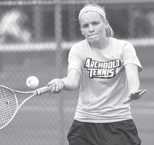 Shelby Cline eyes the ball and returns a forehand in Archbold's first tennis match of the season, Monday, Aug. 12.– photo by Mary Huber