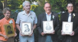 New inductees of the Fulton County Agriculture Hall of Fame are, from left: Jeanne Johnson, Fayette; Phil Liechty, Wauseon, representing his father, Chris Liechty; Robert G. Frey, Archbold; and Richard Henricks, Chesterfield Township. They were honored at a banquet, Monday, Aug. 19, in Ruihley Park.– photo by Mary Huber