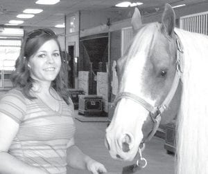 Cassie Norris with Smart And Shiney, a horse owned by Lyle Lovett, a country music artist.– courtesy photo